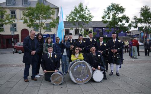 Visitors from Argentina with Longford Pipe Band at The Market Square