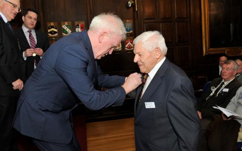 Minister Deenihan confers the Order of Clans of Ireland on Ambassador Ó Ceallaigh