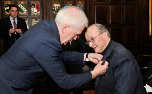 Minister Deenihan confers the Order of Merit on Monsignor Ó Fionnachta