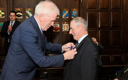 Minister Deenihan confers the Order of Merit on Cathaoir Ó Tighernaigh