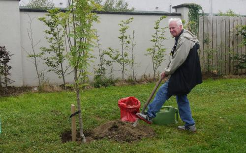 Everet Farrell, Canada, planting a tree in The Garden of Rememberance.
