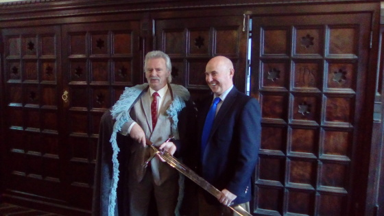The Brosnan presenting the sword to The Cathaoirleach